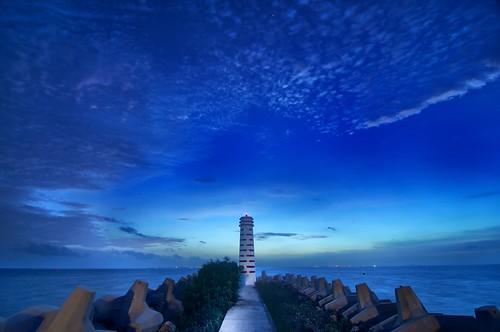 ocean lighthouse clouds sunrise dawn atlanticocean carribbean breakwater signallight puntasam playamujeres excellenceplayamujeres playamujeresmexico puntasammexico puntasammarina
