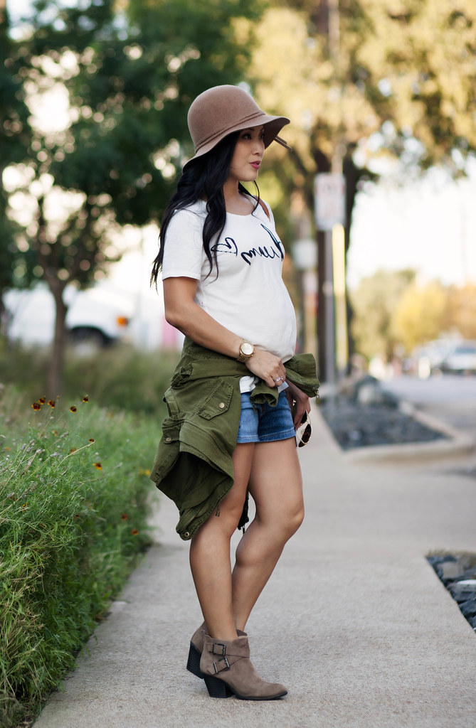 cute & little blog | petite fashion | maternity baby bump pregnant | dream graphic tee, denim shorts, military jacket, felt floppy hat, ankle boots | fall outfit | second trimester 26 weeks