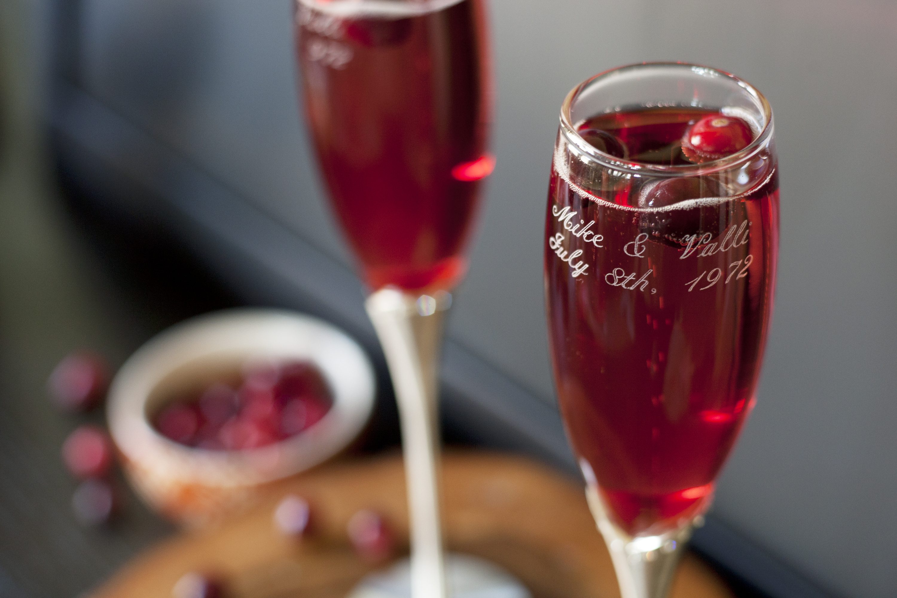 pear cranberry sparkling wine or champagne cocktail in a flute ...
