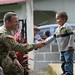 U.S. Army Capt. John Dills, Joint Task Force-Bravo tactical officer in charge, shakes hands with a boy during a medical readiness training exercise in San Jose De Rio Pinto, Honduras, Nov. 12, 2015. The MEDRETEs JTF-B supports provide military members with essential training in austere locations and helps build local community relations in the host country. (U.S. Air Force Photo by Senior Airman Westin Warburton/Released)