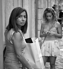 Don't look at my daughter. I was taking a shot of the young lady on the right, when her mother came out of a shop on the left, I just needed a dirty raincoat to compleate the picture!!!!!