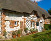 A pretty thatched cottage at Haxton in Wiltshire