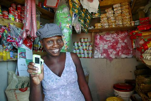 Merchant Belleus Pierre with mobile phone in Haiti, 2010