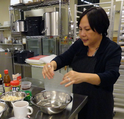 Dipping the rice paper wrappers