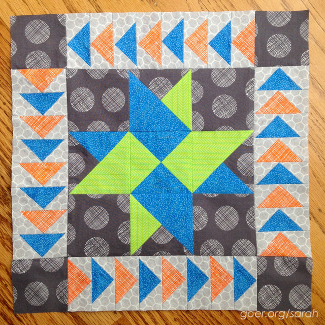 mini medallion quilt in lime, blue, orange and grey with first border on