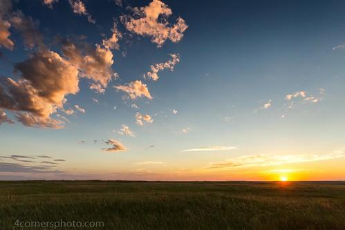 sunset summer sky color horizontal wall clouds southdakota rural landscape scenery unitedstates dusk vegetation northamerica prairie grassland badlandsnationalpark greatplains penningtoncounty badlandsloop 4cornersphoto