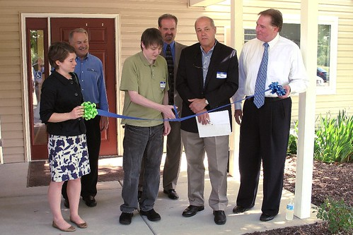 Ribbon-cutting at Kalamink Creek Apartments.  From left:  Melissa Horste, staffer for U.S. Sen. Carl Levin; Senior Vice President of the Great Lakes Capital Fund Tom Edmiston, resident Ryan Kainath; USDA Rural Development Mason Area Office Director Kevin Smith; Owner/Contractor Jeff Gates; co-owner Tom Lapka (USDA Photo)