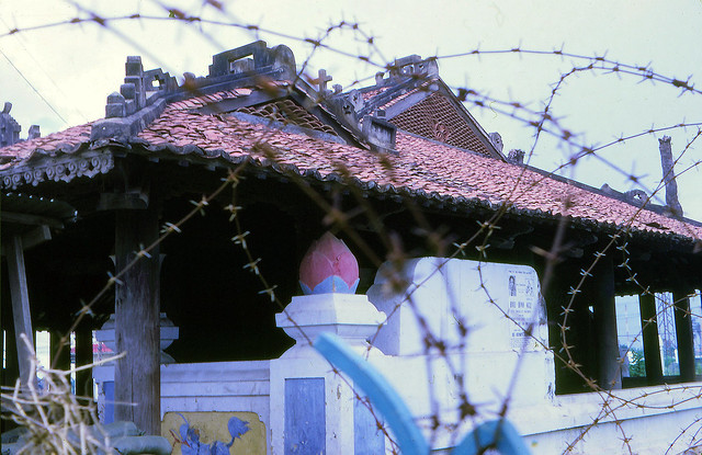 SAIGON 1970 - The Pigneau de Béhaine mausoleum viewed through barbed wire