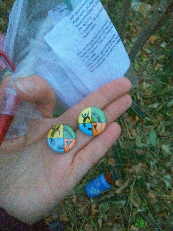 I made some pinback buttons to place inside a new neighborhood cache