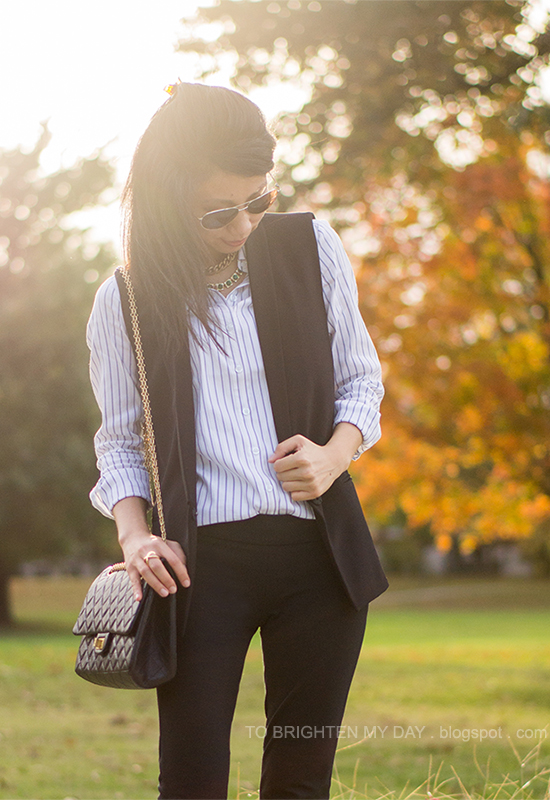 striped dress shirt, black vest, black pants