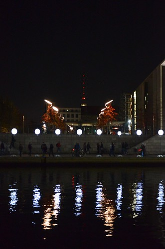 Berlin Fall of The Wall 25 Year Anniversary Lichtgrenze_ lit balloons along Spree river path with Fernsehturm TV tower in background