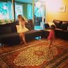 Two little ballerinas, in pink tutus, dancing to Clara de Lune.