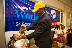 Dr. Pierre Mpele-Kilebou, WHO Representative to Ethiopia vaccinates a child during the World Polio Day Celebration