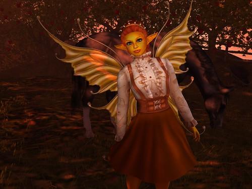 Image Description: Orange girl standing in front of an eating horse.