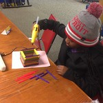 Daijah making a Popsicle stick box