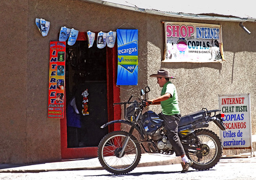 Peru, Arequipa province,  Colca valley, Yanque, motorcyclist outside an internet store  #Ρeru
