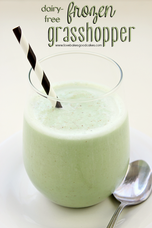 Dairy-Free Frozen Grasshopper in a glass with a straw and a spoon.