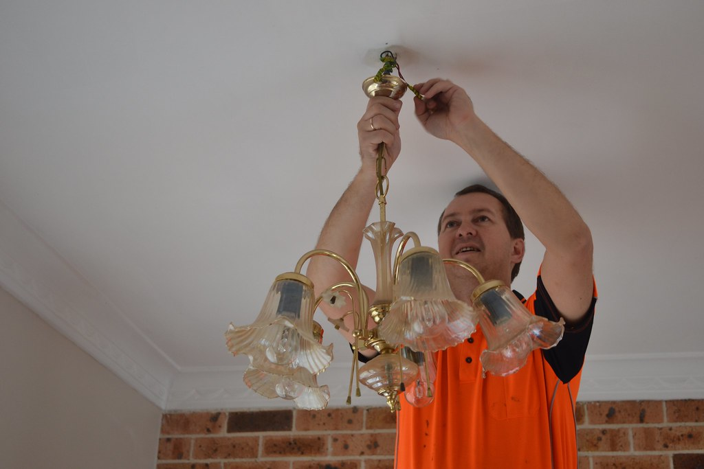 Old chandelier being removed