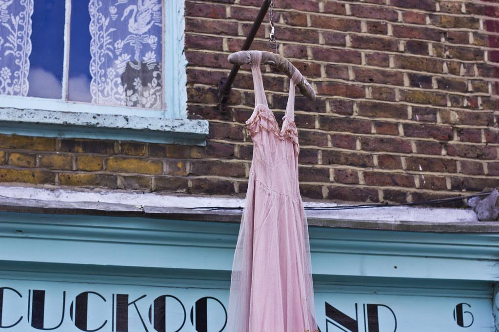 pink dress hanging outside shop decoration camden passage
