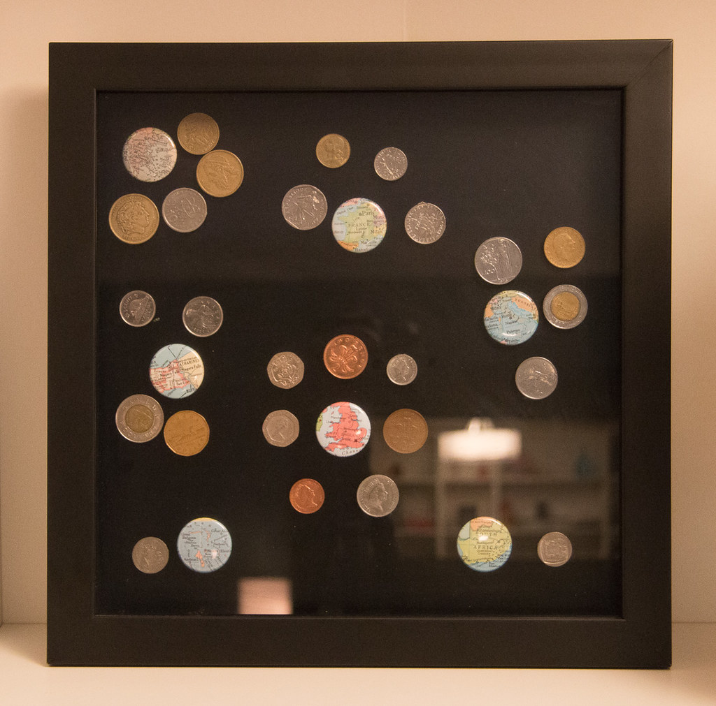 Another shadowbox displaying different foreign coins
