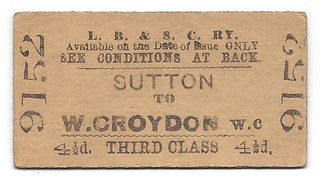 "A small rectangular cardboard railway ticket, printed with the text: ""L. B. & S. C. RY. Available on the Date of Issue ONLY. SEE CONDITIONS AT BACK.  Sutton to W. Croydon W.C.  4 1/2 d. THIRD CLASS 4 1/2 d."" and stamped on either side with the number 9152."