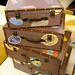 Suitcase shaped nesting storage boxes