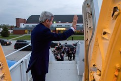 U.S. Secretary of State John Kerry waves goodbye as he prepares to leave Ottawa, Canada on October 28, 2014, after visiting the Canadian capital to pay condolences following last week's attacks and for a series of bilateral meetings with Prime Minister Stephen Harper and Foreign Minister John Baird. [State Department photo/ Public Domain]
