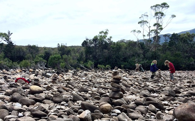 Stacking stones. Old River. Port Davey, Tasmania.
