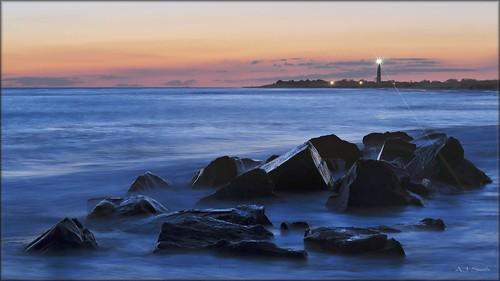 ocean new sunset sea lighthouse blur beach water rocks waves cove may nj atlantic shore jersey cape