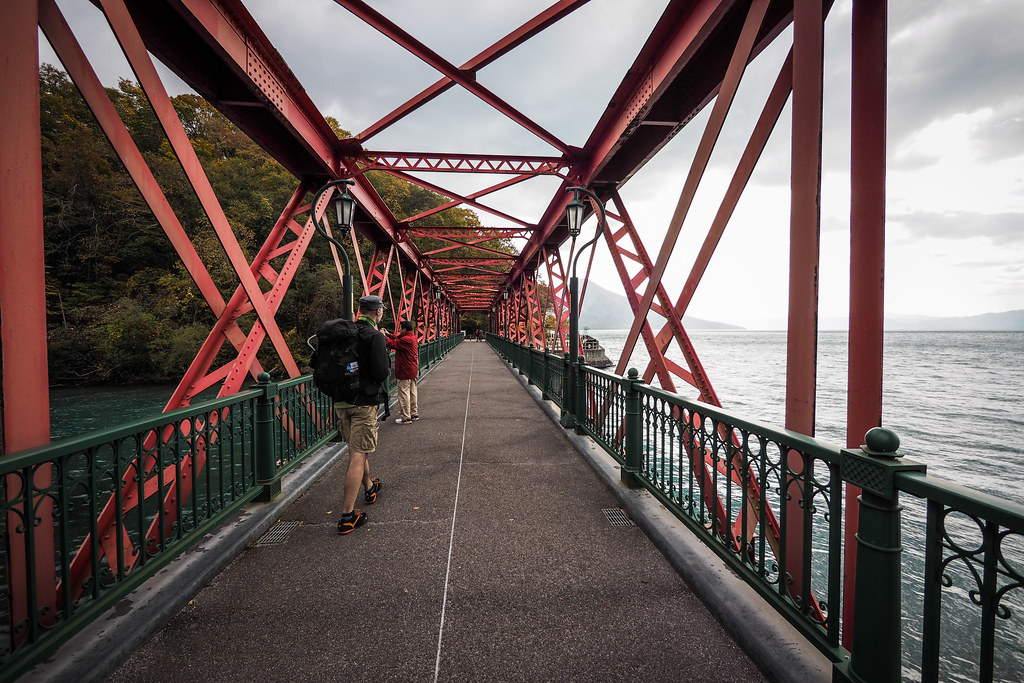 Red iron bridge at Lake Shikotsu, Hokkaido, Japan