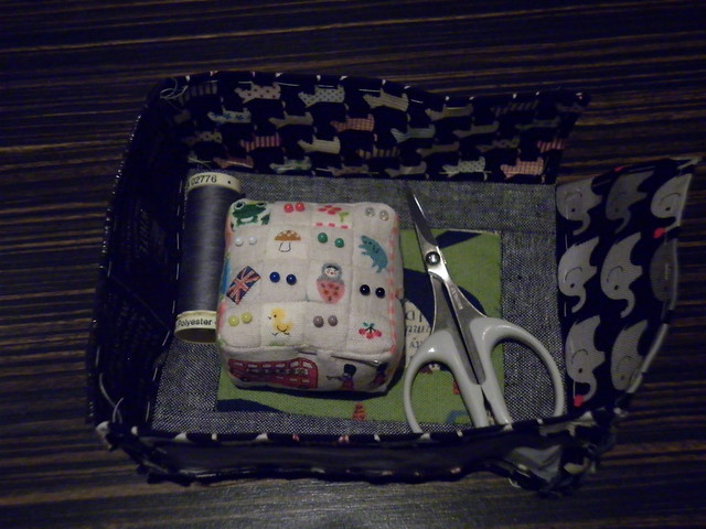 A partly complete pin cushion makes an excellent temporary storage basket!