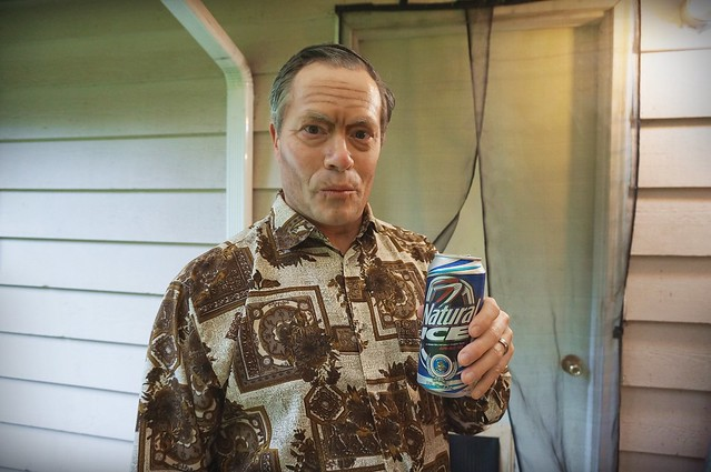 old man drinking a Natty Ice