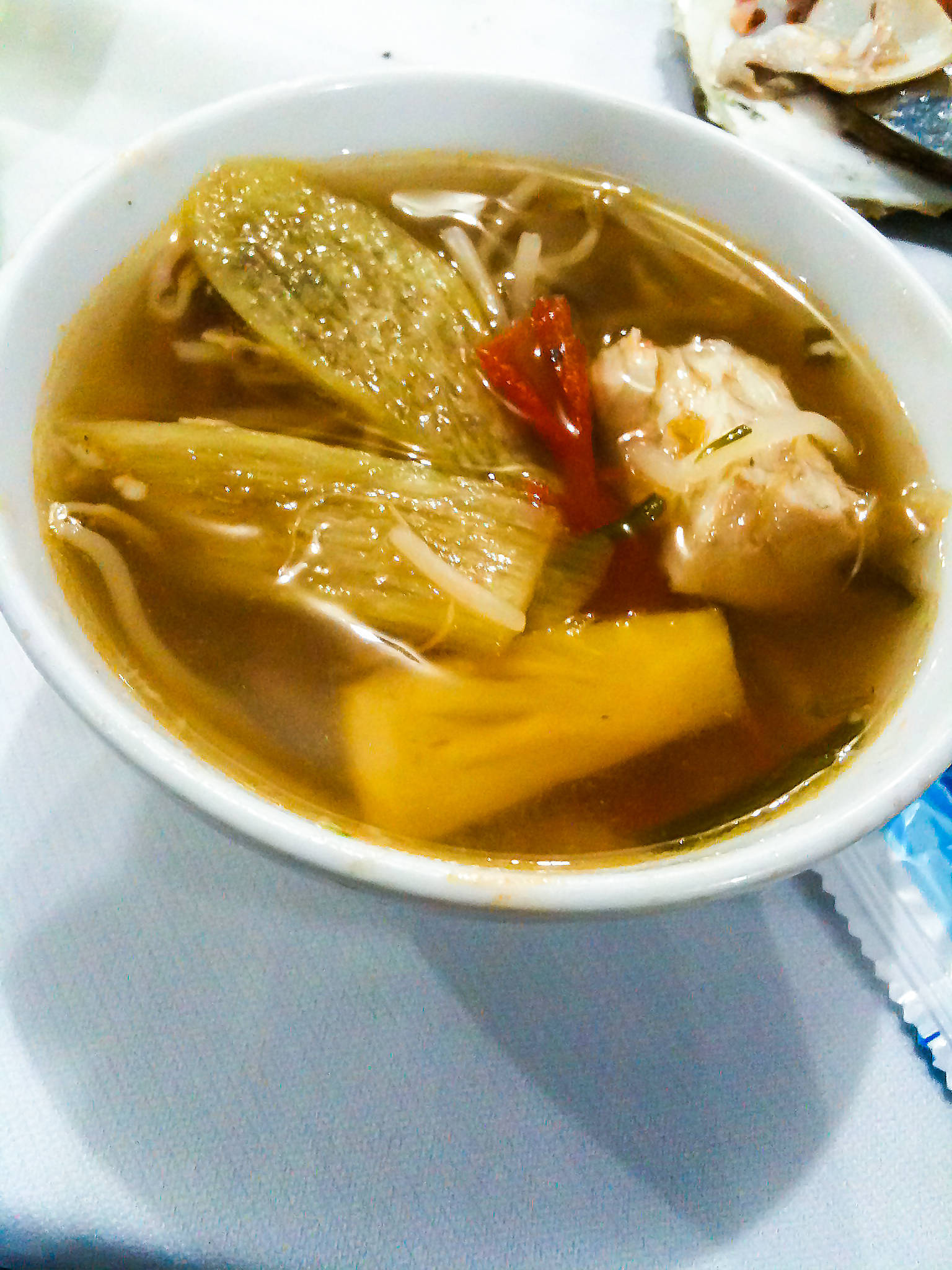 Sweet and sour cobia fish soup (Lau ca bop)