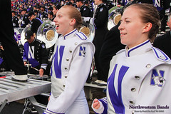 Wildcat Surprise! ::  	   Drum Majors Elisabeth Sladek '16 (l) and Emily Liquin '16 and the Northwestern University 'Wildcat' Marching Band perform at Ryan Field as Northwestern Football hosts Wisconsin on October 4, 2014.  Photo by Daniel M. Reck '08 MSEd.