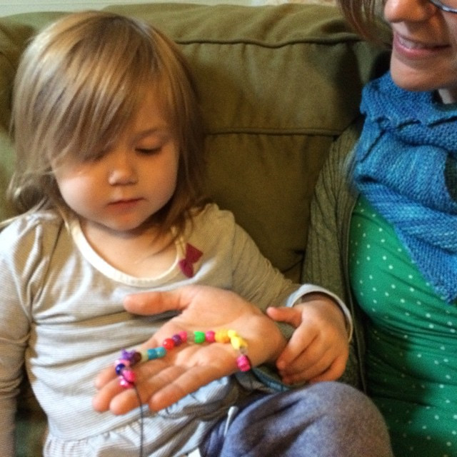 My little sickling strung some beads onto a string for mama.