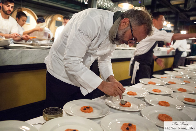 Massimo Bottura plating the salmon with Osetra caviar