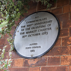 Photo of market charter, Alford white plaque