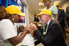H.E. David Usher, Canadian Ambassador to Ethiopia, vaccinates a child at the World Polio Day Celebration
