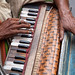 The hands of a musician in the streets of Kolkata, India. by cookiesound