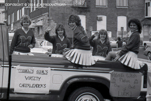 Tri-X Files 84_27.11a: Model High School Girls Varsity Cheerleaders in the Madison High School Homecoming Parade, on Water Street