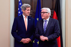 German Foreign Minister Frank-Walter Steinmeier and U.S. Secretary of State John Kerry pose for photographers at Villa Borsig, the German Foreign Office guest house, before a working dinner on Oct. 21, 2014. [State Department photo/ Public Domain]