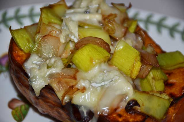 half butternut squash filled with leek and onionmix with melted blue cheese