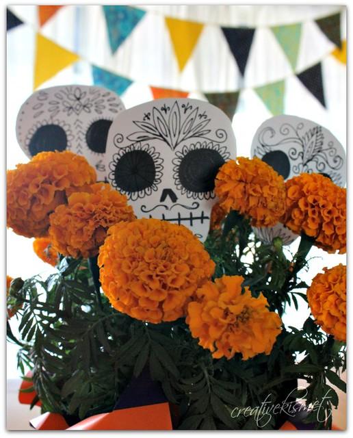 Marigolds with skull planter sticks