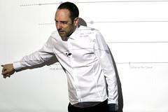 tuxedo(0.0), suit(0.0), brand(0.0), clothing(1.0), dress shirt(1.0), sleeve(1.0), man(1.0), formal wear(1.0), person(1.0), gentleman(1.0),