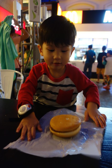 Very proud of his burger and he excitedly open up the burger to show me!