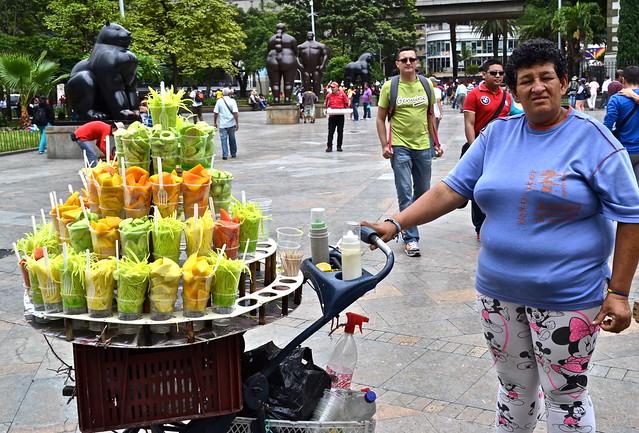 fruit vendor, botero plaza, medellin, colombia