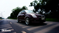 executive car(0.0), nissan(0.0), sports car(0.0), automobile(1.0), automotive exterior(1.0), wheel(1.0), vehicle(1.0), automotive design(1.0), suzuki swift(1.0), mid-size car(1.0), compact car(1.0), land vehicle(1.0),
