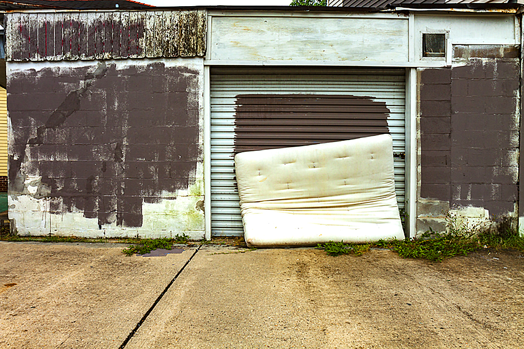 Mattress-in-front-of-garage-door-in-9-14--New-Orleans