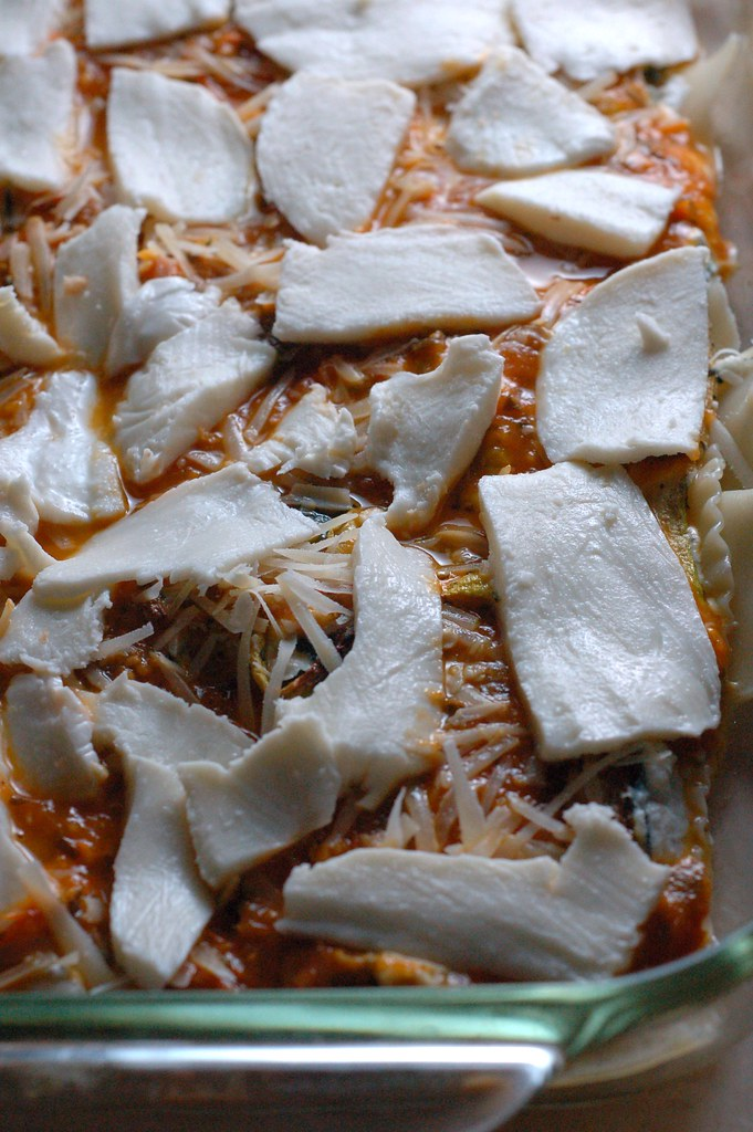 Layering mozzarella on the harvest lasagna by Eve Fox, The Garden of Eating, copyright 2014