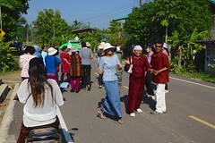 Colourful and joyful Krathin procession through a village in Surin province, Thailand